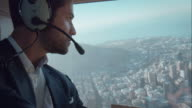 Pilot flying helicopter video