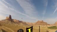 Pilot flying ultralight aircraft beautiful desert canyon video
