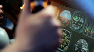 Pilot hands on steering wheel of private airplane, indicators on flight panel video