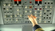 Pilot pushing buttons. video