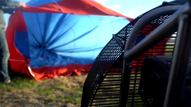Pilots inflate a balloon. slow motion. preparing for flight video