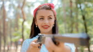 Pin up woman hold gun in her hands video