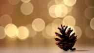 Pine cone on a New year background. video