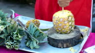 Pineapple fruit cut on wooden block video