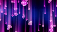 pink hearts with light streaks falling loop video