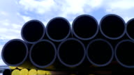 Pipes stacked in construction site video