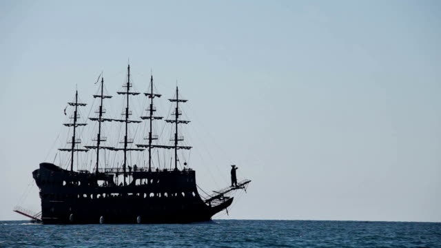 Pirates ship floats by the blue ocean waves video