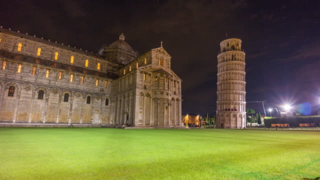 pisa cathedral and famous tower night illumination panorama 4k time lapse italy video