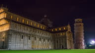 pisa city night illumination cathedral front and tower walking square panorama 4k hyper time lapse italy video