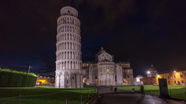 pisa tower and cathedral front entrance night light panorama 4k time lapse italy video