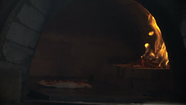 HD: Pizza baking in brick pizza oven video