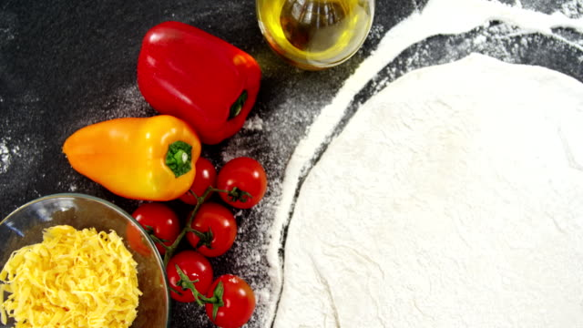 Pizza flour with vegetables on table video
