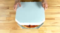 Pizza in a box, male hands video