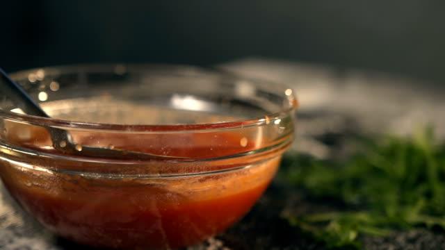 Pizza maker spreading Tomato Sauce video