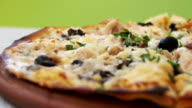 Pizza on a White Wooden Table in a Cafe. Dolly Shot video