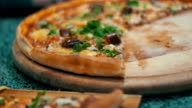 Pizza on a Wooden Platter in the Pizzeria video