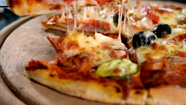 pizza on wooden board. video