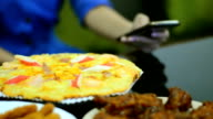 Pizza set and chicken snack on the table serve for meal video