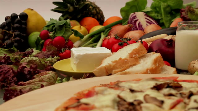 Pizza with fresh vegetables and fruits video