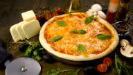 Pizza with mozzarella, cheese and basil leaves video