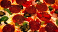 Pizza With Pepperoni, Peppers And Mushrooms video