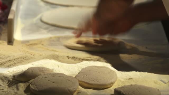 Pizzaiolo Handling Pizza Dough video
