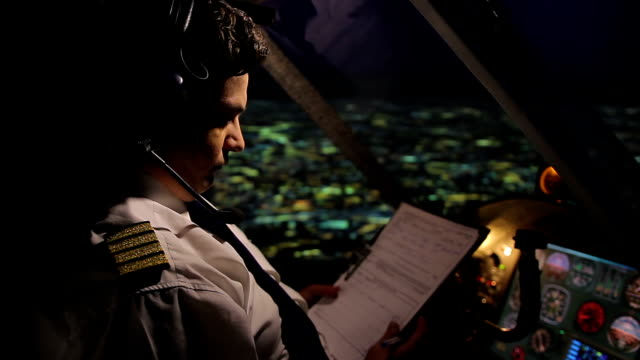 Plane captain flying in autopilot mode, filling out flight report, job duties video