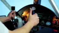 Plane crewmember hands on steering wheel, professional pilot navigating aircraft video