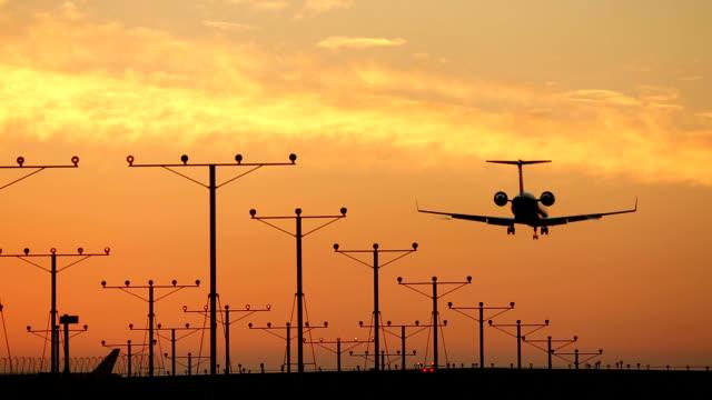 Plane landing at sunset video