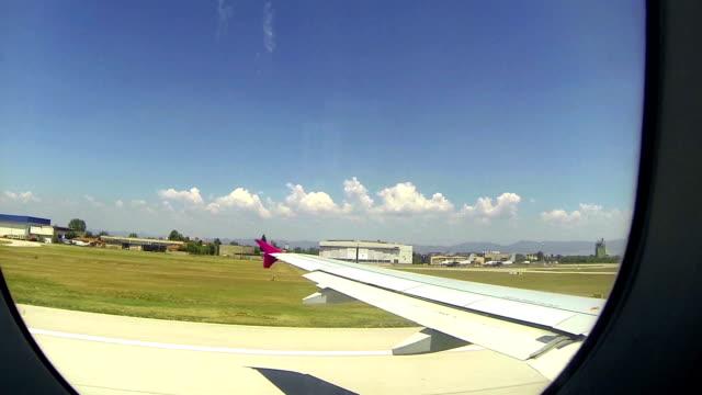 Plane taking off trough cabin window video