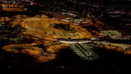 AERIAL Planes parked at terminal Building on Newark Airport, New Jersey at night video