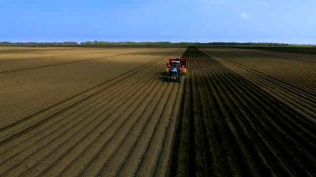 Planting Potatoes With Tractor.The Planter on the Field.The Introduction of Fungicides.Aerial View video