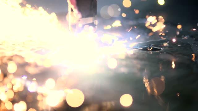 Plasma laser cutting metal sheet with sparks video