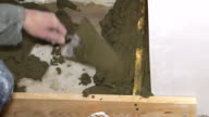 Plasterer working with cement and trowel video