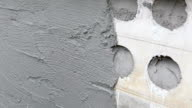 plastering concrete worker at wall of house construction video