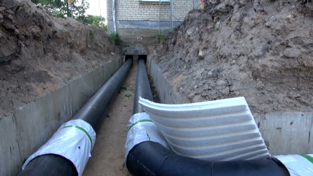 Plastic black central heating pipes video