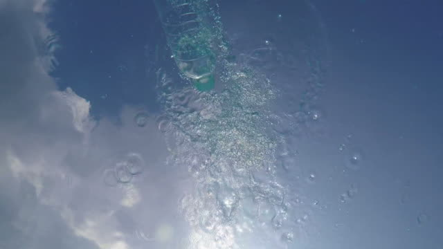 Plastic Bottle Thrown into a Quiet Pool of Clear Fresh Water. video