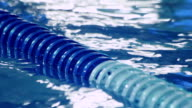 Plastic lanes in swimming pool. Blue lanes of competition swimming pool video