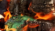 Plastic material burning in flames - close-up video
