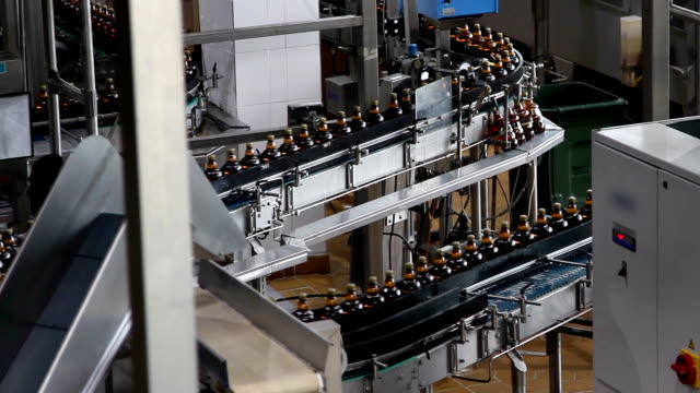 Plastic water bottles on conveyor or water bottling machine video