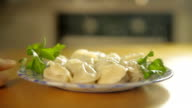 Plate with dumplings on a table video