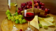 Plate with Grapes, Cheese and Glasses of Wine. video