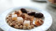 Plate with oriental sweets shot in close-up. video