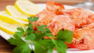 Plate with shrimp, lemon and parsley video
