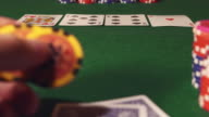 POKER: Player thinks and throws a playing chips video