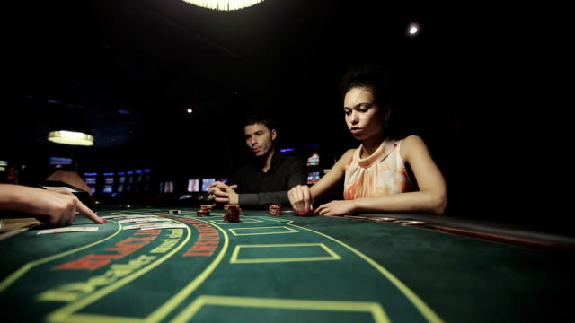 Players in casino, play in blackjack card game video