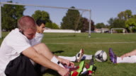 Players Putting On Cleats video