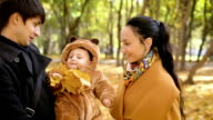 Playful baby with parents in the forest video