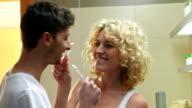 Playful Couple Brushing Teeth video