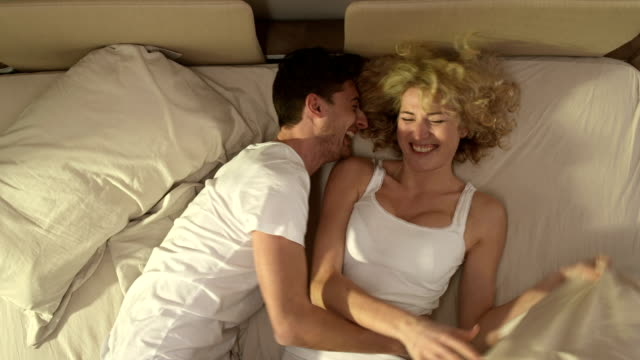 Playful Couple On The Bed video